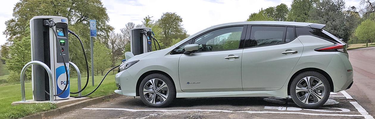 Photograph of an electric vehicle charging at a charging point