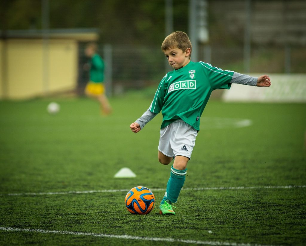 Decorative image of a child playing football