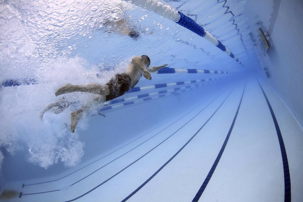 decorative image of a swimmer